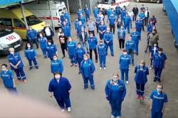 In this handout photo taken from video footage, medical workers record s video appeal to Russian President Vladimir Putin in Armavir, Russia, Saturday, May 16, 2020