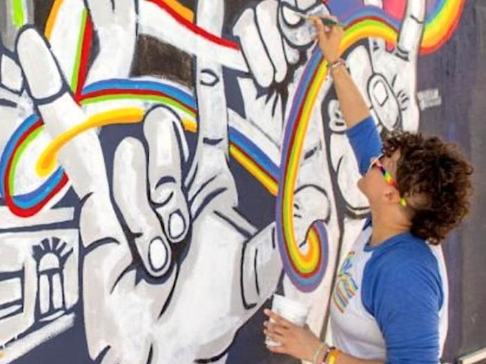 """Acclaimed artist Lisa Marie Thalhammer paints the mural """"Spirit of Stonewall"""" in Key West, Florida."""