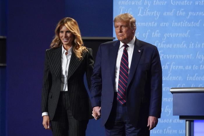 President Donald Trump and first lady Melania Trump hold hands on stage after the first presidential debate at Case Western University and Cleveland Clinic, in Cleveland, Ohio.