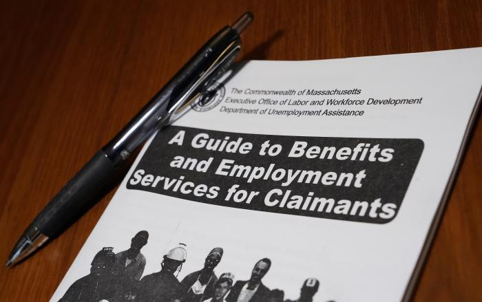 In this Nov. 5, 2020, file photo, a booklet describing unemployment benefits is seen on a desk, in North Andover, Mass.