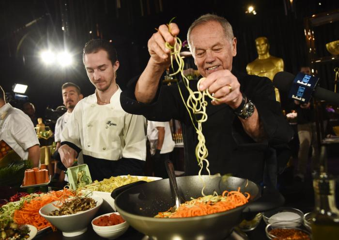 Chef Wolfgang Puck right, and his son Byron make a pasta dish at the Governors Ball Press Preview for the 92nd Academy Awards in Los Angeles on Jan. 31, 2020.