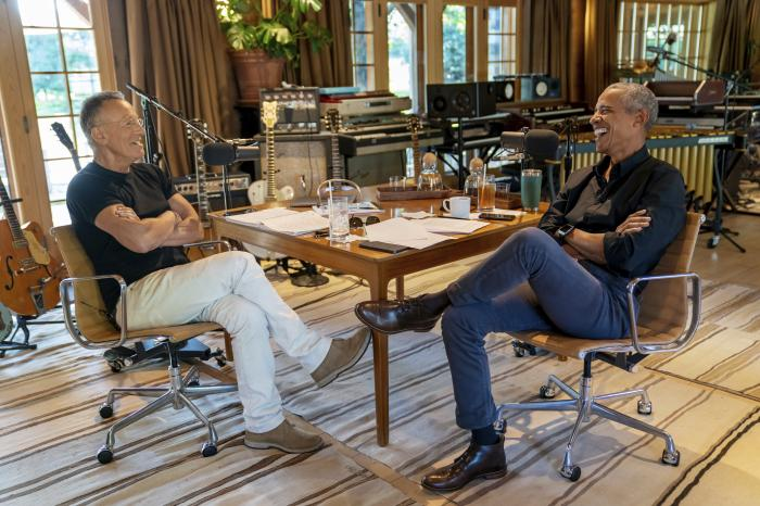 Bruce Springsteen, left, appears with former President Barack Obama during their podcast of conversations recorded at Springsteen's home studio in New Jersey.
