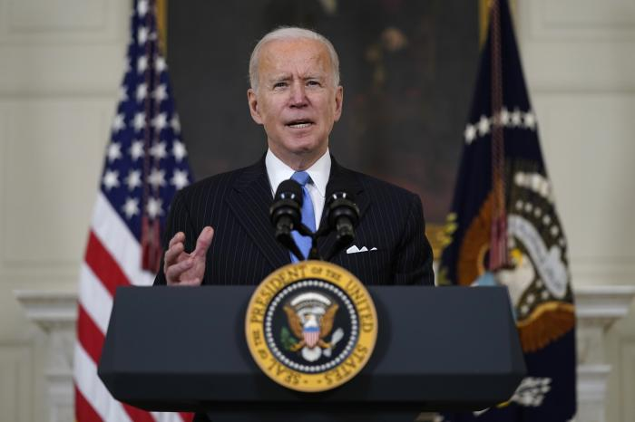 President Joe Biden speaks about efforts to combat COVID-19, in the State Dining Room of the White House.