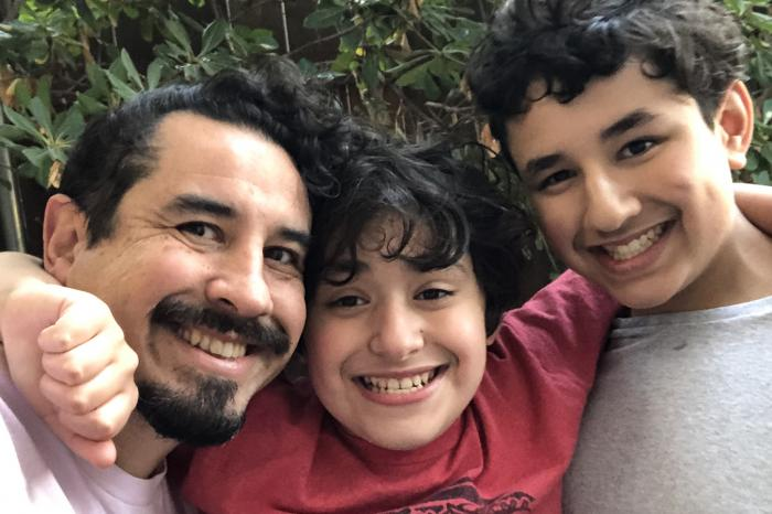 Oscar Madrigal and his two sons, who have both been diagnosed with autism.