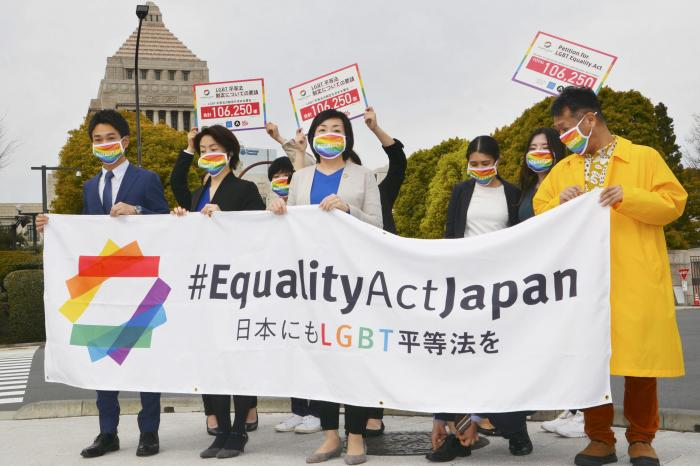 Activists gather in front of parliament before they submit a petition in Tokyo.