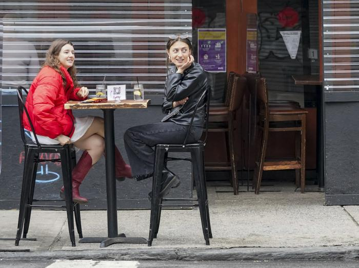 Diners sit at outdoor tables at a restaurant on the Lower East Side Neighborhood of New York.