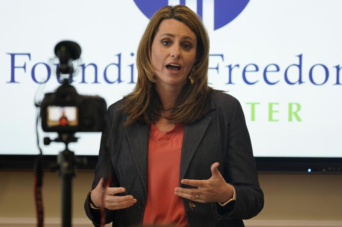 Victoria Cobb, of The Family Foundation, gestures during a news conference at the foundation offices in Richmond, Va.