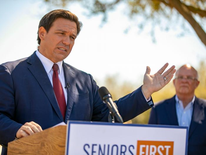 In this March 5, 2021 file photo, Florida Gov. Ron DeSantis speaks to the media as he visited the drive-thru COVID-19 vaccination site at On Top of the World in Ocala, Fla.,