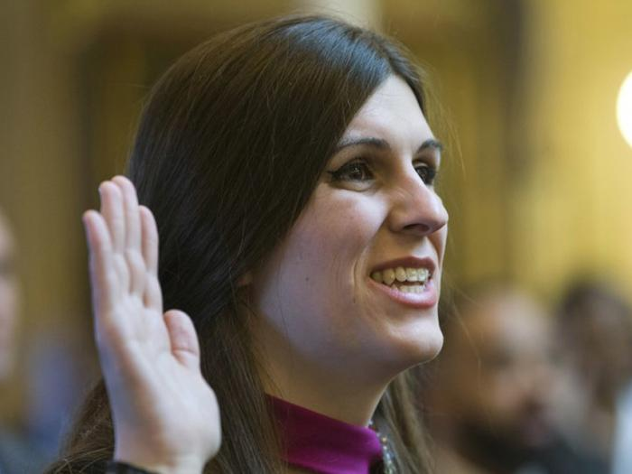 In this Jan. 10, 2018 file photo, Del. Danica Roem, D-Prince William, the first transgender delegate, takes her oath of office during opening ceremonies of the 2018 session of the Virginia House of Delegates at the Capitol in Richmond, Va.