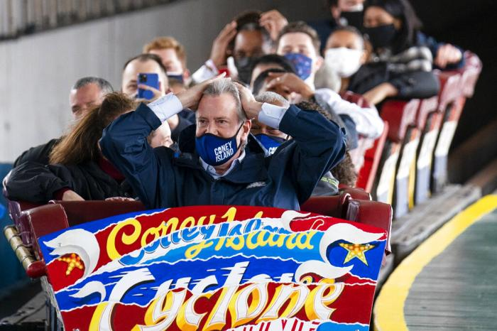 New York City Mayor Bill de Blasio finishes a ride on the Cyclone rollercoaster after attending the ribbon cutting and seasonal opening of the Coney Island amusement park area, Friday, April 9, 2021.