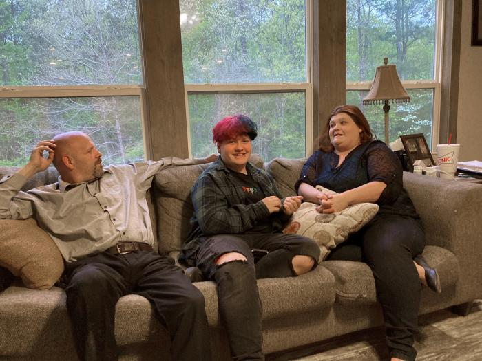 Andrew Bostad, center, talks with his mother, Brandi Evans and stepdad Jimmy Evans at their home in Bauxite, Ark.