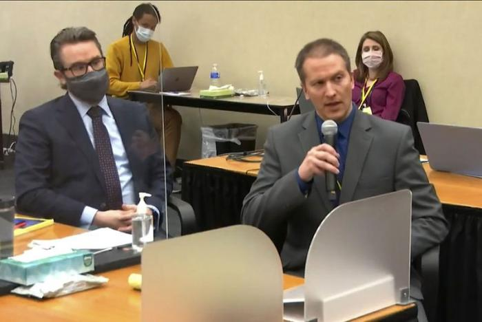 In this image from video, defense attorney Eric Nelson, left, and defendant, former Minneapolis police officer Derek Chauvin