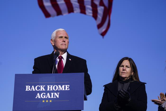 In this Jan. 20, 2021, file photo, former Vice President Mike Pence speaks after arriving back in his hometown of Columbus, Ind., as his wife Karen watches.