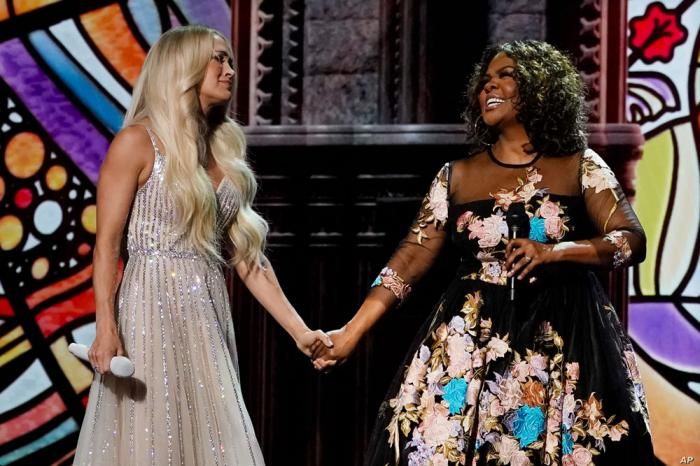 Carrie Underwood, left, and CeCe Winans perform at the 56th annual Academy of Country Music Awards on Saturday, April 17, 2021.