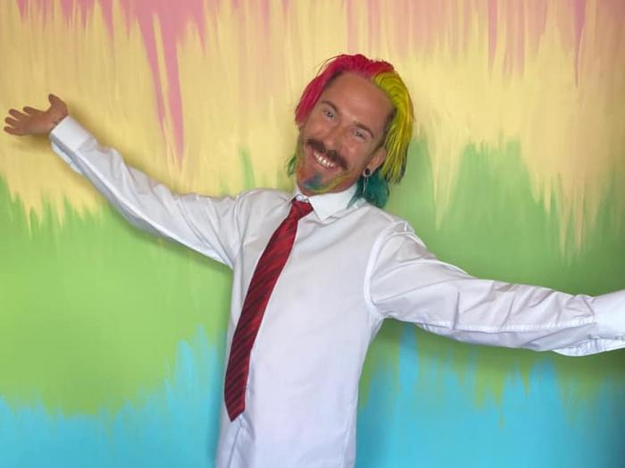 Mykey O'Halloran in his newly rainbow-painted home