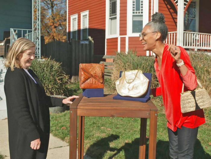 "This image released by WGBH-TV shows Katy Kane, left, as she appraises celebrity chef Carla Hall's vintage purse collection in an episode of ""Antiques Roadshow Celebrity Edition,"" airing May 10 on PBS."