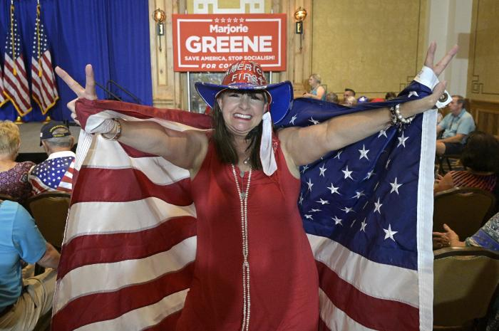 An attendee who only gave her name as Sherry dances in the crowd during a rally featuring Rep. Matt Gaetz, R-Fla. and Rep. Marjorie Taylor Greene, R-Ga., Friday, May 7, 2021, in The Villages, Fla. (AP Photo/Phelan M. Ebenhack)