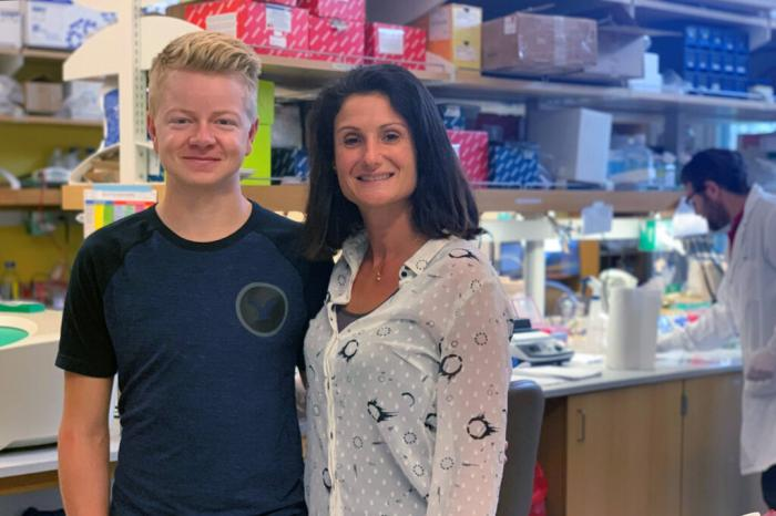 Stephanie Cherqui (right) and patient Jordan Janz in her research lab in La Jolla, Calif.