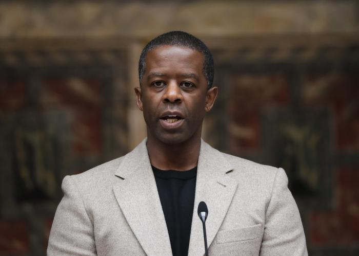 In this May 10, 2021 file photo, British actor Adrian Lester speaks on stage at the official signing in ceremony for Sadiq Khan as the Mayor of London at Shakespeare's Globe Theatre in London.