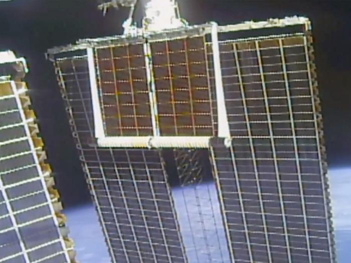 In this image taken from NASA video, a solar panel is unfolded at the International Space Station, Sunday, June 20 2021
