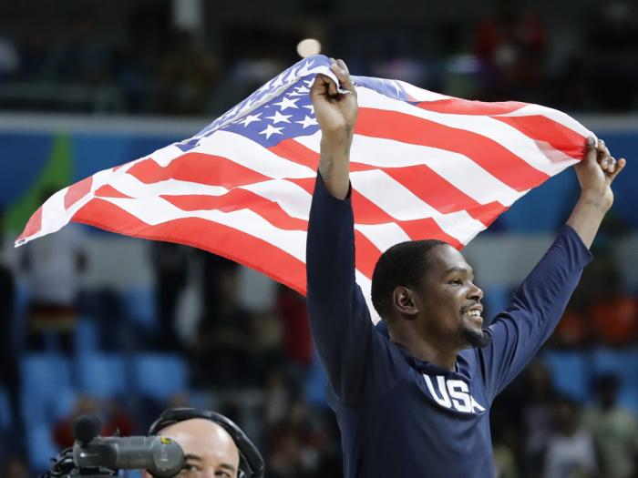 In this Aug. 21, 2016, file photo, United States' Kevin Durant celebrates after the team won gold in men's basketball at the Summer Olympics in Rio de Janeiro