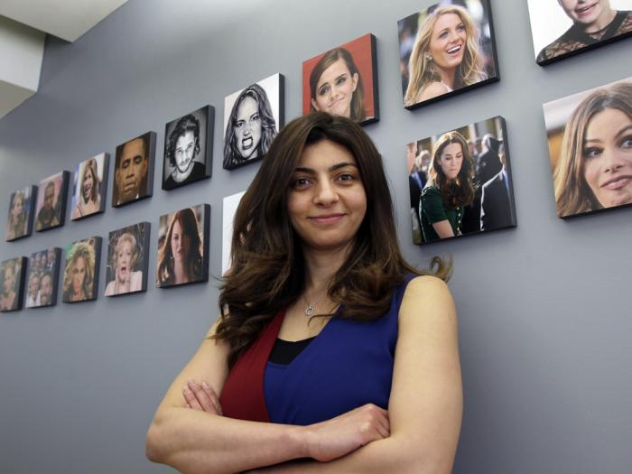 This April 23, 2018 file photo shows Rana el Kaliouby, CEO of the Boston-based artificial intelligence firm, Affectiva, poses in Boston