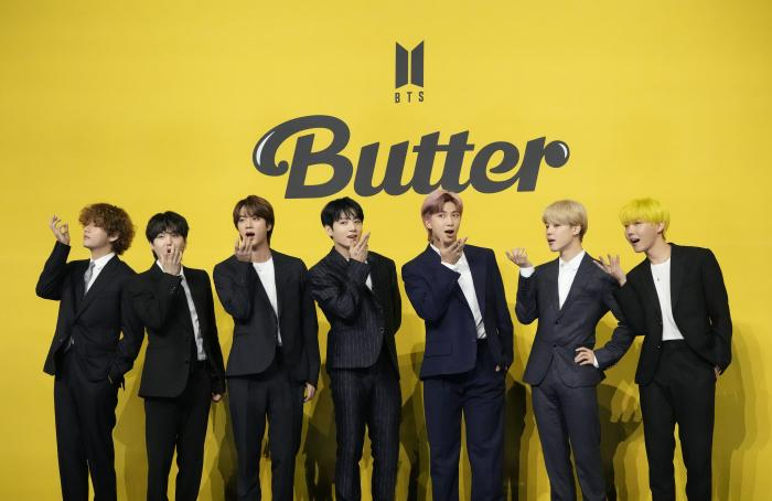 """In this May 21, 2021, file photo members of South Korean K-pop band BTS pose for photographers ahead of a press conference to introduce their new single """"Butter"""" in Seoul, South Korea."""